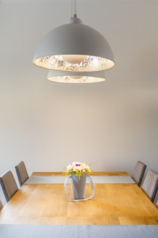 Wood dining table and lamp