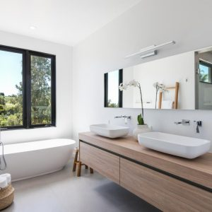 The beach house bathroom in glass and natural shades